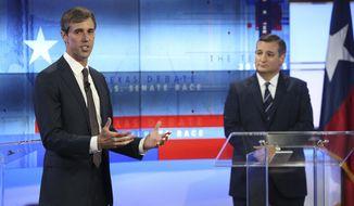 U.S. Rep. Beto O'Rourke, D-Texas, left, and U.S. Sen. Ted Cruz, R-Texas, right, take part in a debate for the Texas U.S. Senate, Tuesday, Oct. 16, 2018, in San Antonio. (Tom Reel/San Antonio Express-News via AP, Pool)