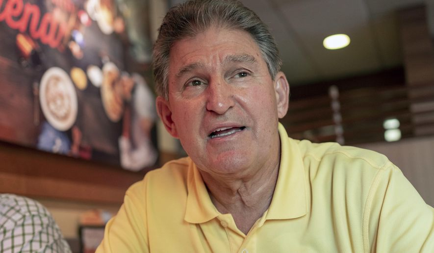 Democrat Senator Joe Manchin speaks about his recent vote in the Senate to confirm Brett Kavanaugh, Sunday, Oct. 7, 2018 at IHOP Charleston W.Va. A day after Manchin broke with his party on what may be the most consequential vote of the young Trump era, the West Virginia Democrat faces a political firestorm back home.(AP Photo/Tyler Evert)