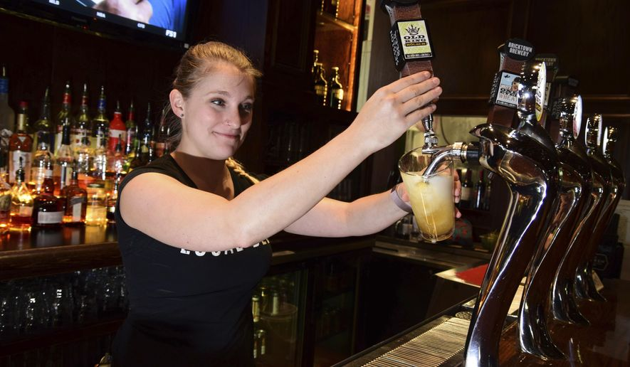 Hillary James draws an Old King Kolsch beer at the Bricktown Brewery, October 5, 2018, in Oklahoma City. Under the old alcohol laws, restaurants that served craft beer, better known as brewpubs, were not allowed to brew beer above 3.2 percent alcohol by volume. When the laws changed this month, that regulation was gone. (Mark Hancock/The Journal Record via AP)