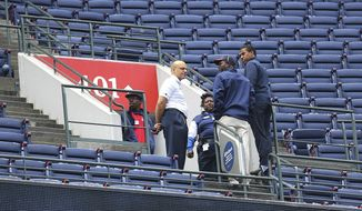 FILE - In this Sunday, Aug. 30, 2015 file photo, Atlanta Braves employees stand at the portal of section 401 near where fan Gregory K. Murrey, 60, Alpharetta, Ga., fell from the top deck to his death during a baseball game between the Braves and the New York Yankees in Atlanta. Attorneys for the family of an Atlanta Braves fan who fell from the upper deck of Turner Field to his death in 2015 say Major League Baseball bears responsibility for not mandating higher guard rails at all stadiums. (Curtis Compton /Atlanta Journal-Constitution via AP, File)