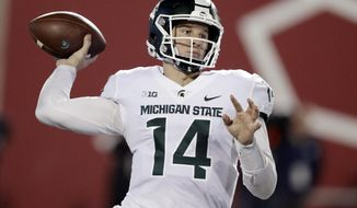 FILE - In this Sept. 22, 2018, file photo, Michigan State quarterback Brian Lewerke throws during the first half of an NCAA college football game against Indiana in Bloomington, Ind. It's been an up-and-down season for Michigan State quarterback Brian Lewerke, who now faces the nation's top-ranked pass defense when the Spartans take on Michigan this weekend.  (AP Photo/Darron Cummings, File)