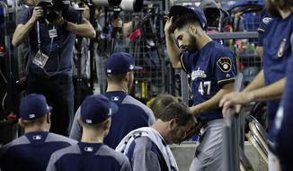 Milwaukee Brewers starting pitcher Gio Gonzalez leaves the game after injuring his ankle during the second inning of Game 4 of the National League Championship Series baseball game against the Los Angeles Dodgers Tuesday, Oct. 16, 2018, in Los Angeles. (AP Photo/Matt Slocum)