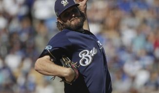 Milwaukee Brewers' Wade Miley throws during the first inning of Game 5 of the National League Championship Series baseball game against the Los Angeles Dodgers Wednesday, Oct. 17, 2018, in Los Angeles. (AP Photo/Jae Hong)