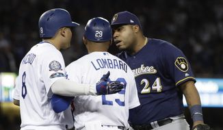 Milwaukee Brewers' Jesus Aguilar and Los Angeles Dodgers' Manny Machado have words during the 10th inning of Game 4 of the National League Championship Series baseball game Tuesday, Oct. 16, 2018, in Los Angeles. (AP Photo/Matt Slocum) **FILE**