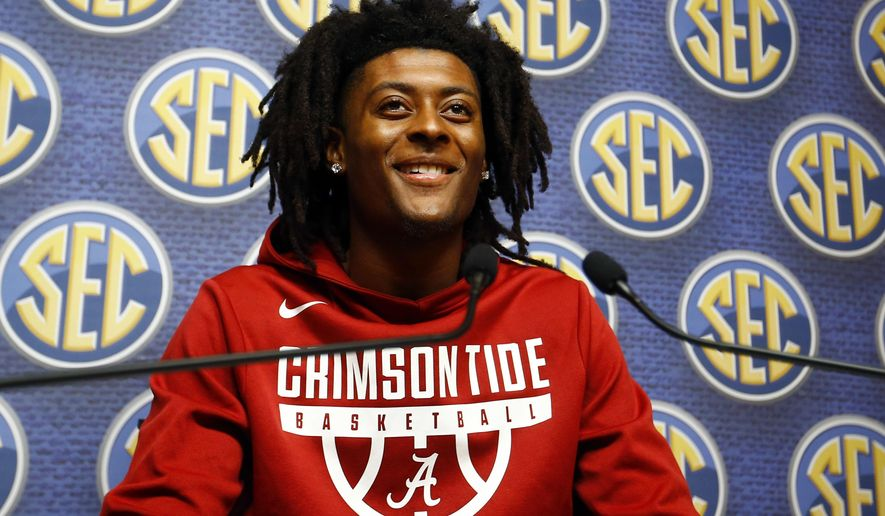 Alabama player John Petty speaks during the SEC men's NCAA college basketball media day, Wednesday, Oct. 17, 2018, in Birmingham, Ala. (AP Photo/Butch Dill)