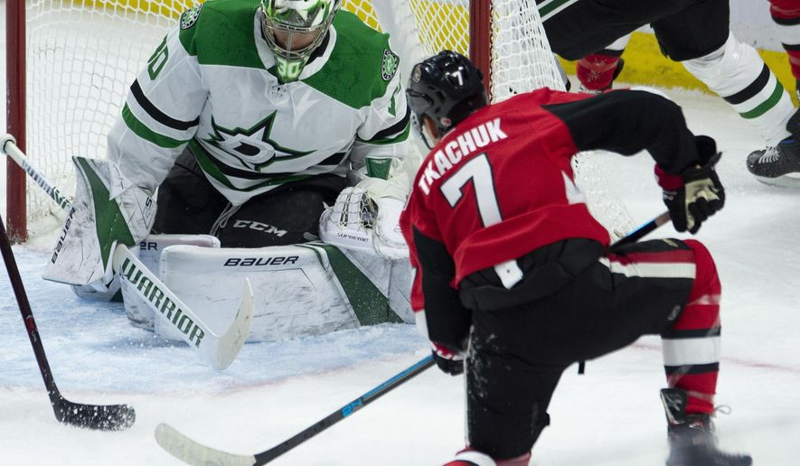 Ottawa Senators left wing Brady Tkachuk fires the puck wide of the net past Dallas Stars goaltender Ben Bishop during second period NHL hockey action Monday, Oct. 15, 2018 in Ottawa. (Adrian Wyld/The Canadian Press via AP)