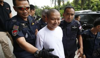 In this Thursday, July 20, 2017, Ex-monk Wirapol Sukphol is escorted by the Department of Special Investigation officials to the prosecutor's office in Bangkok, Thailand. A court in Thailand has sentenced Wirapol, a former Buddhist monk known for his jet-set lifestyle, to 16 years in prison for raping a 13-year-old girl who he also impregnated. (AP Photo/Sakchai Lalit)