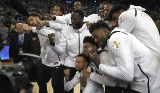 The Golden State Warriors celebrate after receiving their championship rings after an awards ceremony to recognize the team's NBA championship prior to a basketball game against the Oklahoma City Thunder, Tuesday, Oct. 16, 2018, in Oakland, Calif. (AP Photo/Ben Margot) ** FILE **