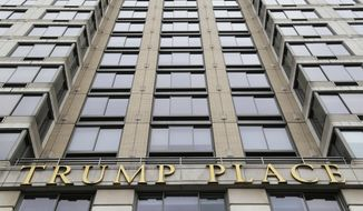"""In this Thursday, Jan. 11, 2018 file photo, gold letters spell out """"Trump Place"""" on the front of a New York City condominium building. Residents in another New York City tower have voted to remove the Trump name from their building in a sign that the Republican president's brand is losing some its power. The condominium owners at Trump Place on the Upper West Side of Manhattan have joined three other buildings in the neighborhood in deciding to strip the president's brassy five-letter name from their 46-story building.(AP Photo/Seth Wenig, File)"""