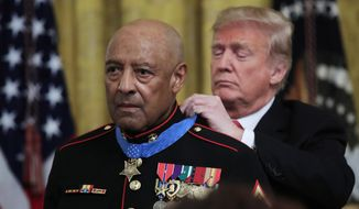 President Donald Trump presents the Medal of Honor to U.S. Marines Corps retired Sgt. Maj. John Canley, during an East Room ceremony at the White House in Washington, Wednesday, Oct. 17, 2018. Canley is the 300th Marine to receive the nation's highest military medal. (AP Photo/Manuel Balce Ceneta)