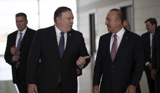 Turkey's Foreign Minister Mevlut Cavusoglu, right, and U.S. Secretary of State Mike Pompeo speak at the Esenboga Airport in Ankara, Turkey, Wednesday, Oct. 17, 2018. Pro-government newspaper Yeni Safak on Wednesday said it had obtained audio recordings of the alleged killing of Saudi writer Jamal Khashoggi inside the Saudi Arabia Consulate in Istanbul on Oct. 2.(Cem Ozdel/Turkish Foreign Ministry via AP, Pool)