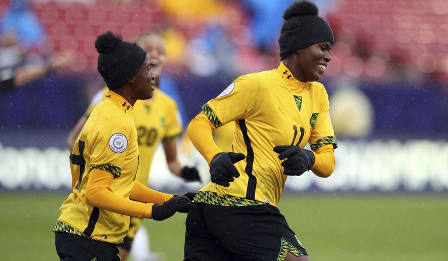 Jamaica midfielder Deneisha Blackwood (14) celebrates the goal by midfielder Khadija Shaw (11) during the first half against Panama in the third place match of the CONCACAF women's World Cup qualifying tournament, Wednesday, Oct. 17, 2018, in Frisco, Texas. (AP Photo/Richard W. Rodriguez)