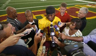 Washington Redskins quarterback Robert Griffin III speaks to reporters after NFL football practice, Tuesday, Aug. 18, 2015, in Ashburn, Va. (AP Photo/Alex Brandon) **FILE**