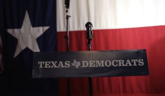 A Texas Democrats sign hangs on a podium at a Democratic watch party following the Texas primary election, Tuesday, March 6, 2018, in Austin, Texas. (AP Photo/Eric Gay)