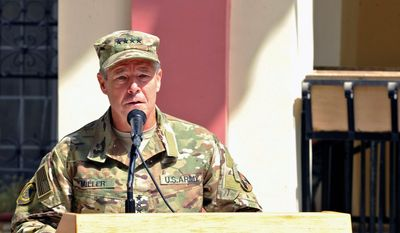 In this September 2, 2018 photo, provided by the U.S. Air Force, U.S. Army Gen. Scott Miller, commander of U.S. and NATO troops in Afghanistan, delivers remarks during the Resolute Support mission change of command ceremony in Kabul, Afghanistan. Afghan officials said Thursday, Oct. 18, 2018 that three top Kandahar province officials have been killed by their own guards in an attack at a security meeting that also wounded two U.S. troops. A Taliban spokesman who claimed responsibility for the attack tells The Associated Press that Miller, was the target. NATO officials say Miller escaped unharmed. (U.S. Air Force/Tech. Sgt. Sharida Jackson, via AP)