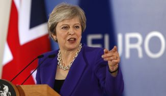 British Prime Minister Theresa May speaks during a media conference at an EU summit in Brussels, Thursday, Oct. 18, 2018. EU leaders met for a second day on Thursday to discuss migration, cybersecurity and to try and move ahead on stalled Brexit talks. (AP Photo/Alastair Grant)