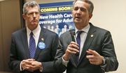 Virginia Gov. Ralph Northam, right, gestures during a press conference along with Virginia Secretary of Health, Daniel Carey, in Richmond, Va., Thursday, Oct. 18, 2018. Northam announced a key approval in the medicaid expansion process that will allow Virginia to begin accepting applications for expanded health coverage. (AP Photo/Steve Helber)
