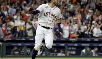 Houston Astros' Carlos Correa celebrates his RBI-single against the Boston Red Sox during the fifth inning in Game 4 of a baseball American League Championship Series on Wednesday, Oct. 17, 2018, in Houston.(AP Photo/David J. Phillip)