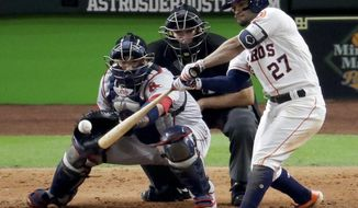 Houston Astros' Jose Altuve hits a RBI-double against the Boston Red Sox during the eighth inning in Game 4 of a baseball American League Championship Series on Wednesday, Oct. 17, 2018, in Houston. (AP Photo/Lynne Sladky)