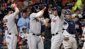 Boston Red Sox's Rafael Devers, right, celebrates his three-run home run against the Houston Astros during the sixth inning in Game 5 of a baseball American League Championship Series on Thursday, Oct. 18, 2018, in Houston.(AP Photo/David J. Phillip)