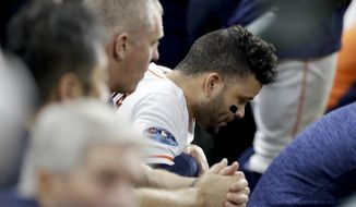 Houston Astros' Jose Altuve sits in the dugout during the eighth inning in Game 5 of a baseball American League Championship Series against the Boston Red Sox on Thursday, Oct. 18, 2018, in Houston. (AP Photo/David J. Phillip)