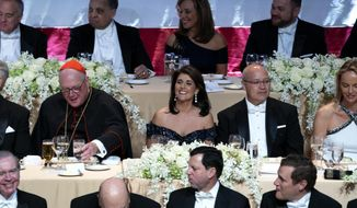 Keynote speaker Ambassador to the United Nations Nikki Haley, center, shares a light moment as she attends the 73rd Annual Alfred E. Smith Memorial Foundation Dinner Thursday, Oct. 18, 2018, in New York. Left is Archbishop of New York Cardinal Timothy Dolan, and right is Michael Haley, husband of Nikki Haley. (AP Photo/Craig Ruttle)