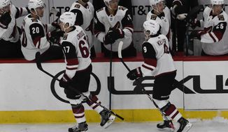 Arizona Coyotes' Lawson Crouse (67) celebrates his goal against the Chicago Blackhawks with his teammates during the first period of an NHL hockey game Thursday, Oct. 18, 2018, in Chicago. (AP Photo/David Banks)