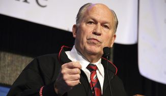 """Alaska Gov. Bill Walker addresses delegates at the annual Alaska Federation of Natives conference in Anchorage, Alaska, on Thursday, Oct. 18, 2018. Walker says his re-election campaign is moving ahead but says he's taking it """"a day at a time"""" just days after the abrupt resignation of Lt. Gov. Byron Mallott over what Walker has described as an inappropriate overture to a woman. (AP Photo/Mark Thiessen)"""