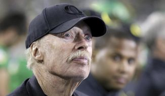 FILE - In this Sept. 26, 2015, file photo, Phil Knight watches the second half of an NCAA college football game between Utah and Oregon in Eugene, Ore. Knight has given another $1 million to the Oregon gubernatorial campaign of Republican Rep. Knute Buehler. (AP Photo/Ryan Kang, File)