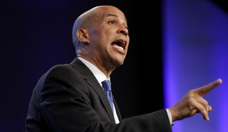 In this Oct. 6, 2018, file photo, Sen. Cory Booker, D-N.J., speaks during the Iowa Democratic Party's annual Fall Gala, in Des Moines, Iowa. (AP Photo/Charlie Neibergall)