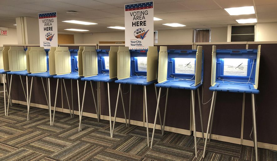 In this Sept. 20, 2018, file photo, voting booths stand ready in downtown Minneapolis for the opening of early voting in Minnesota. (AP Photo/Steve Karnowski) ** FILE **
