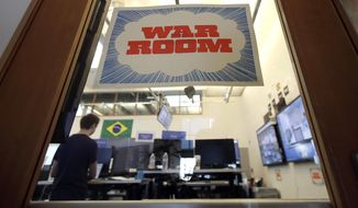 A man works at his desk in the war room, where Facebook monitors election related content on the platform, in Menlo Park, Calif., Wednesday, Oct. 17, 2018. (AP Photo/Jeff Chiu)