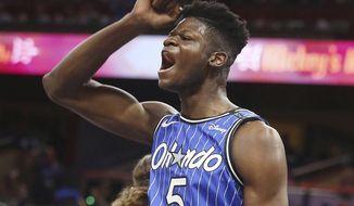 Orlando center Mo Bamba celebrates during an NBA basketball game against the Miami Heat Wednesday, Oct. 17, 2018, in Orlando, Fla. Orlando won the game 104-101. (Stephen M. Dowell/Orlando Sentinel via AP)