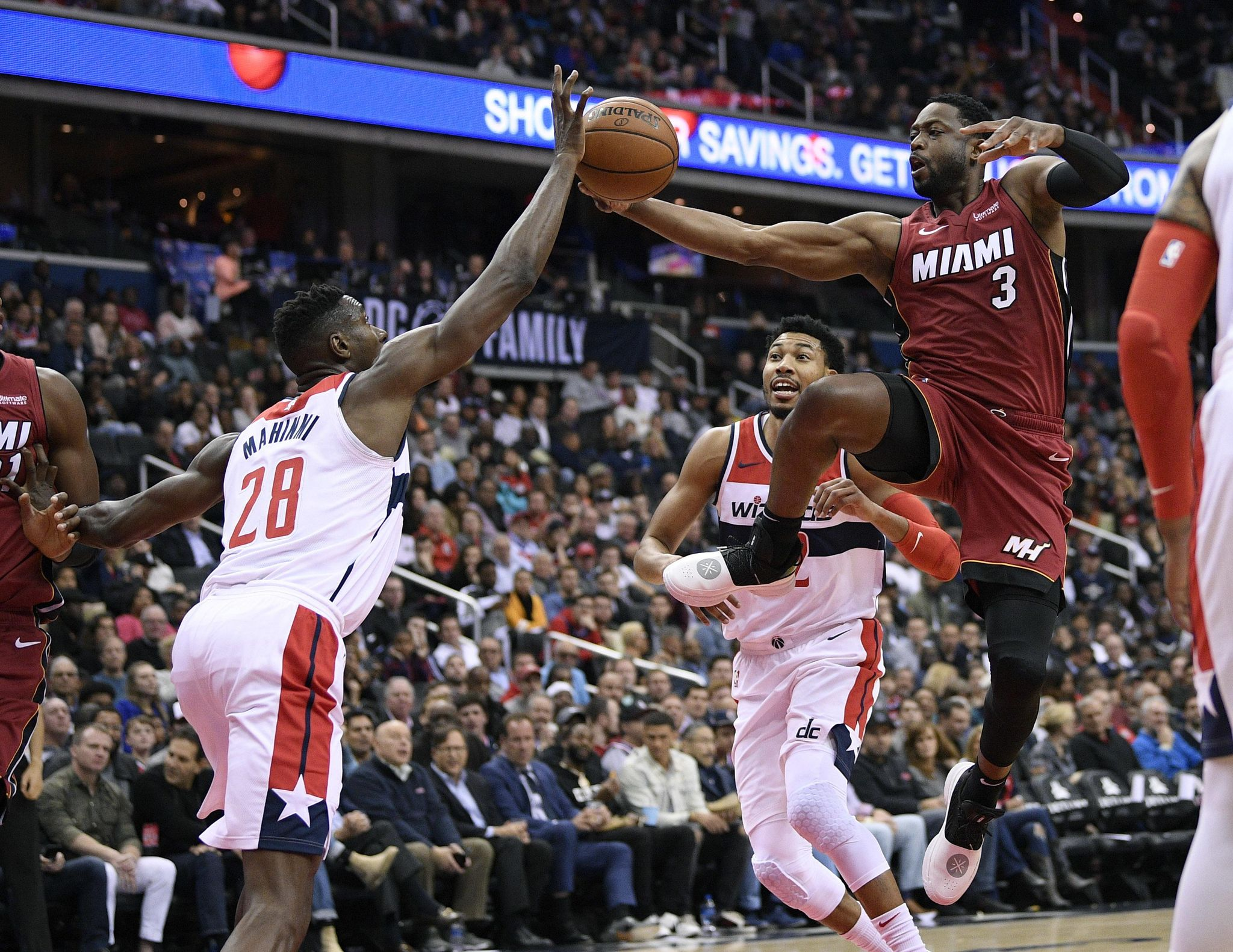 Olynyk's putback off Wade's miss lifts Heat past Wiz 113-112 - Washington Times
