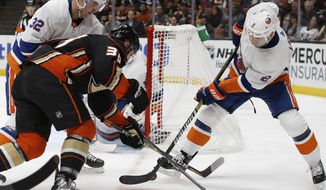 New York Islanders left wing Ross Johnston, left, and defenseman Nick Leddy, right, defend against Anaheim Ducks center Joseph Blandisi, center, during the second period of an NHL hockey game in Anaheim, Calif., Wednesday, Oct. 17, 2018. (AP Photo/Alex Gallardo)