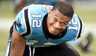 FILE - In this Aug. 24, 2018, file photo, Carolina Panthers' DJ Moore (12) warms up before a preseason NFL football game against the New England Patriots in Charlotte, N.C. Despite two costly fumbles in a 23-17 loss to the Washington Redskins last Sunday, the Panthers say they still have confidence in Moore and will continue to develop the first-round pick. (AP Photo/Mike McCarn, File)