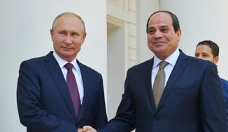 Russian President Vladimir Putin, left, and Egyptian President Abdel-Fattah el-Sissi, shake hands during their meeting in Sochi, Russia, Wednesday, Oct. 17, 2018. (Alexei Druzhinin, Sputnik, Kremlin Pool Photo via AP)