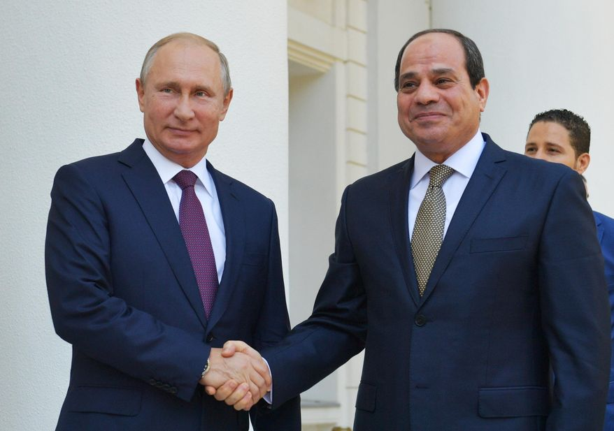 Russian President Vladimir Putin, left, and Egyptian President Abdel-Fattah el-Sissi, shake hands during their meeting in Sochi, Russia, Wednesday, Oct. 17, 2018. (Alexei Druzhinin, Sputnik, Kremlin Pool Photo via AP)