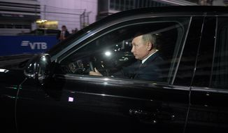 Russian President Vladimir Putin, right, drives the Aurus, or Cortege, limousine during his meeting with Egyptian President Abdel-Fattah el-Sissi at the Sochi Autodrom circuit in Sochi, Russia, Wednesday, Oct. 17, 2018. (Alexei Druzhinin, Sputnik, Kremlin Pool Photo via AP)