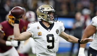 FILE - In this Oct. 8, 2018, file photo, New Orleans Saints quarterback Drew Brees (9) passes in the first half of an NFL football game against the Washington Redskins, in New Orleans. The Saints play at the Baltimore Ravens on Sunday. (AP Photo/Gerald Herbert, File)