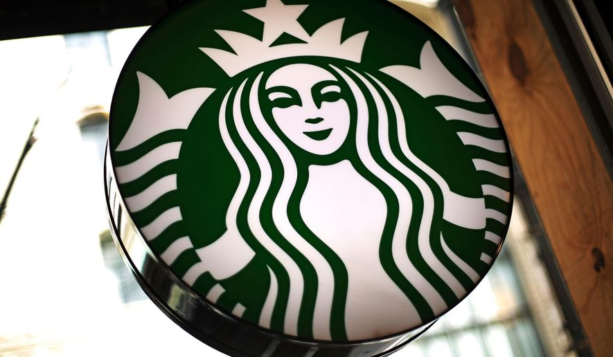 This March 24, 2018, file photo shows a sign in a Starbucks located in downtown Pittsburgh. Starbucks is restructuring its European operations after several years of slowing sales. (AP Photo/Gene J. Puskar, File)