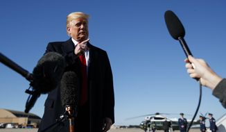 President Donald Trump talks to reporters as before boarding Air Force One, Thursday, Oct. 18, 2018, in Andrews Air Force Base, Md., en route to campaign stops in Montana, Arizona and Nevada. (AP Photo/Carolyn Kaster)