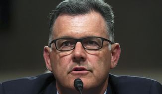 In this Tuesday, June 5, 2018, file photo, former USA Gymnastics president Steve Penny invokes his right under the Fifth Amendment not to answer questions during a Senate Subcommittee on Consumer Protection, Product Safety, Insurance, and Data Security, on Capitol Hill in Washington. In a statement late Wednesday, Oct. 17, 2018, the Walker County district attorney's office in Huntsville, Texas, said that Penny has been arrested after a Texas grand jury indicted him, alleging he tampered with evidence in the sexual assault investigation of now-imprisoned gymnastics doctor Larry Nassar. Penny now awaits extradition to Texas. (AP Photo/Carolyn Kaster, File)