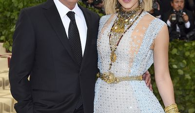 David Foster, born 1949 and Katharine McPhee, born 1984, Age Difference: 34 years                           David Foster, left and Katharine McPhee attend The Metropolitan Museum of Art's Costume Institute benefit gala celebrating the opening of the Heavenly Bodies: Fashion and the Catholic Imagination exhibition on Monday, May 7, 2018, in New York. (Photo by Evan Agostini/Invision/AP)
