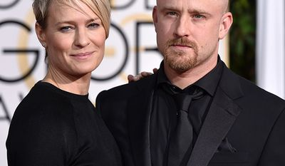 Robin Wright, born 1966 and Ben Foster, born 1980, Age Difference: 14 years                                    Robin Wright, left, and Ben Foster arrive at the 72nd annual Golden Globe Awards at the Beverly Hilton Hotel on Sunday, Jan. 11, 2015, in Beverly Hills, Calif. (Photo by John Shearer/Invision/AP)