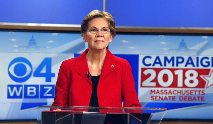 Democratic candidate for U.S. Senate from Massachusetts, incumbent Elizabeth Warren stands at the podium before a debate with her opponent Geoff Diehl in Boston, Friday, Oct. 19, 2018. (AP Photo/Michael Dwyer)