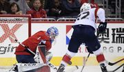 Washington Capitals goaltender Pheonix Copley (1) battles for the puck against Florida Panthers center Frank Vatrano (72) during the third period of an NHL hockey game, Friday, Oct. 19, 2018, in Washington. (AP Photo/Nick Wass)