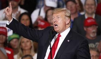 President Donald Trump speaks at a campaign rally Friday, Oct. 19, 2018, in Mesa, Ariz. Trump is in Arizona stumping for Senate candidate Martha McSally. (AP Photo/Matt York)