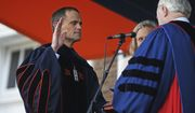 Jim Ryan is sworn in during his inauguration as president of the University of Virginia in front of Old Cabell Hall Friday Oct. 19, 2018 in Charlottesville, Va. Ryan, who graduated from the University's school of law as well as Harvard university, is the ninth president in school history. (Zack Wajsgras/The Daily Progress via AP)