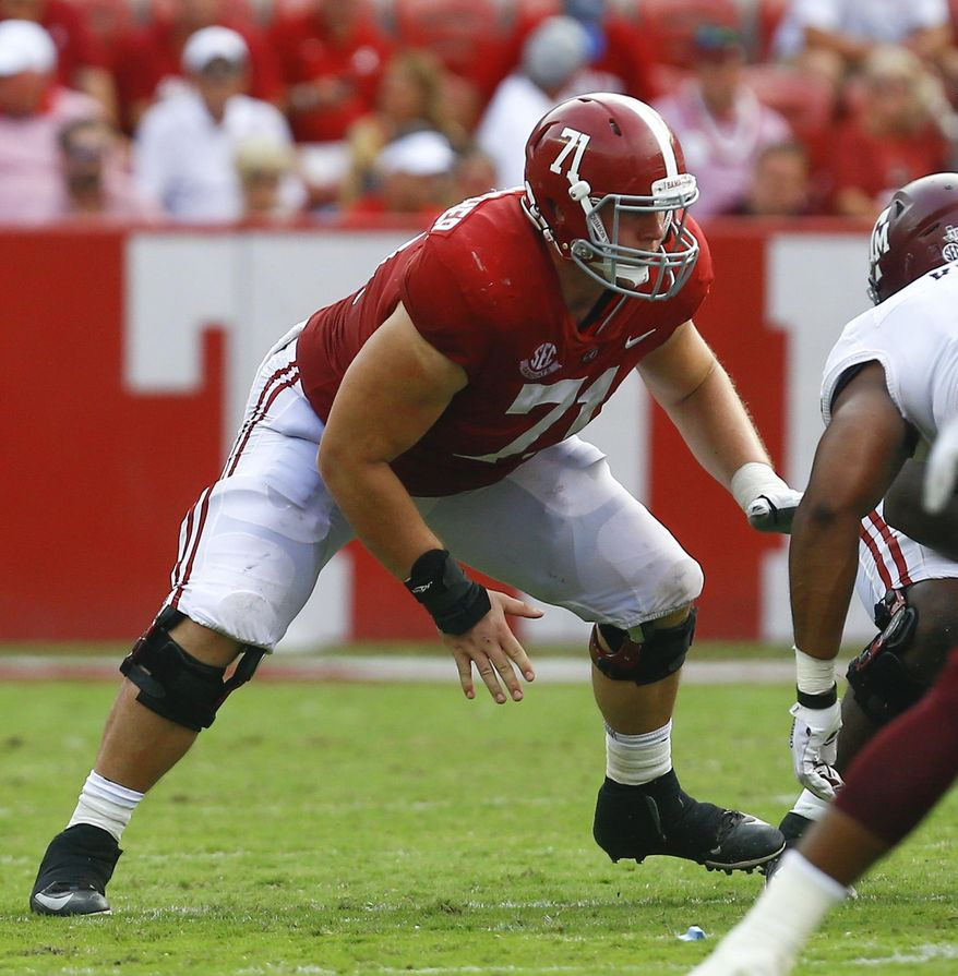 In this Sept. 22, 2018, file photo, Alabama offensive lineman Ross Pierschbacher (71) blocks out against Texas A&M during the second half of an NCAA college football game, in Tuscaloosa, Ala. Pierschbacher was named to The Associated Press Midseason All-America team, Tuesday, Oct. 16, 2018. (AP Photo/Butch Dill, File)